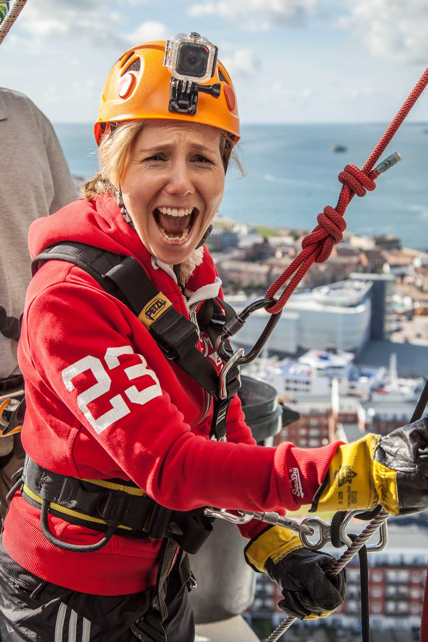 Sally Phillips at the top of the Spinnaker Tower preparing to abseil
