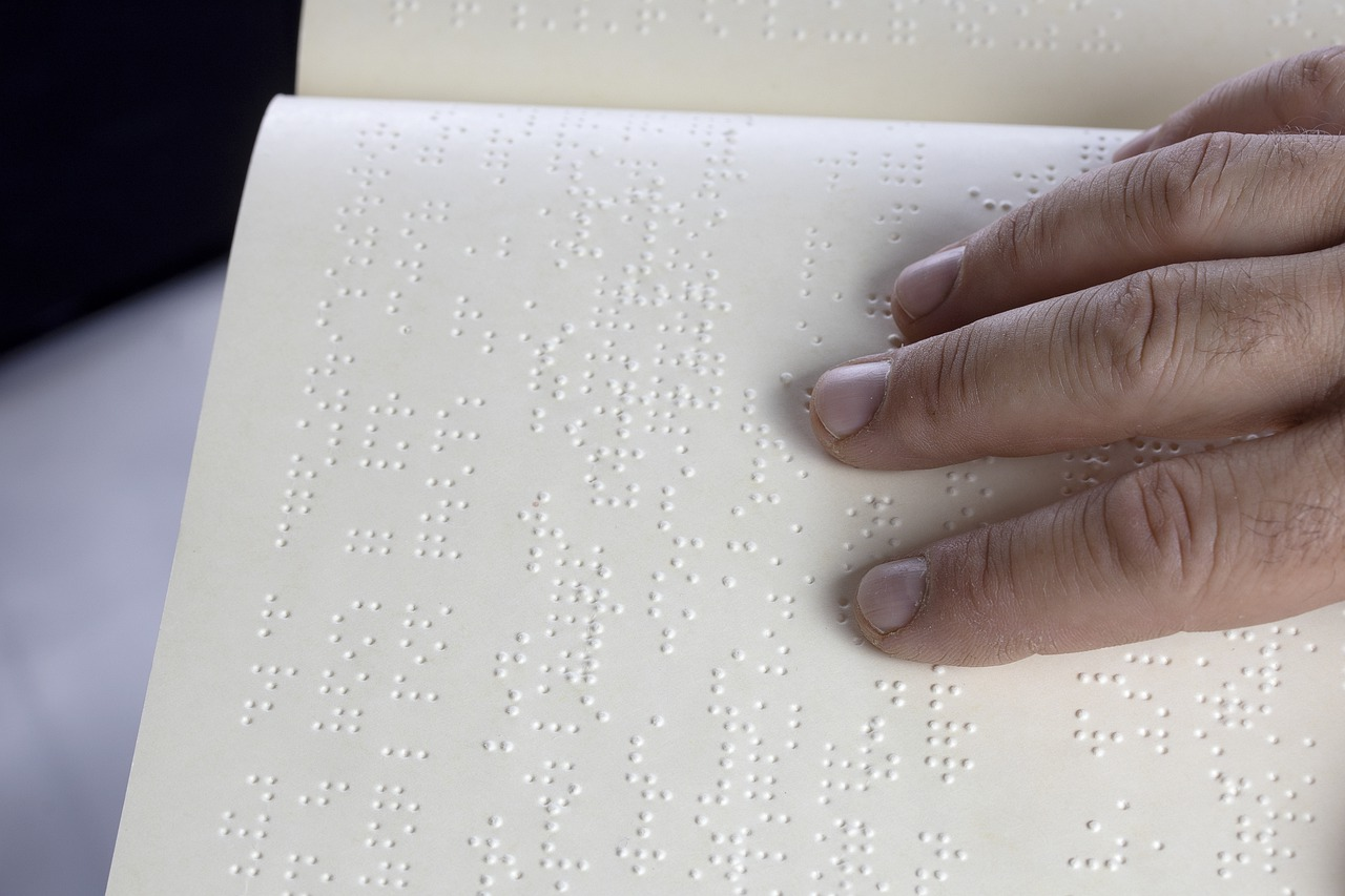 A persons fingers over braille